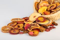 Close Up Of Organic Raw Sun Dried Fruits Pouring From Basket Mix royalty free stock photo