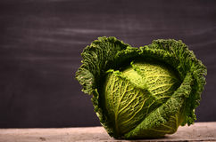 Close up of organic savoy cabbage on the wooden background Stock Photography