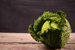 Close up of organic savoy cabbage on the wooden background Royalty Free Stock Photos