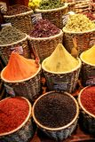 A close-up of oriental spices poured into wicker baskets. In the Turkish bazaar Stock Photo