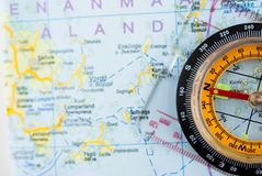 Orienteering Compass and Map. A close-up of an orienteering compass and map. Orienteering compass on a detailed map royalty free stock photography