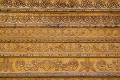 Close up ornamental wood  carvings on the wall of monasteries in Royalty Free Stock Images