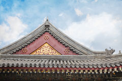 Close-up of ornate roof tiles on Chinese building. Stock Photos