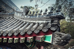 Close-up of ornate roof tiles on Chinese building. Royalty Free Stock Photo