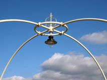 Close up of the ornate victorian lights on the historic southport pier against a blue summer sky with clouds. A close up of the ornate victorian lights on the stock photos