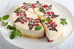 Tasty cheesecake with bottom layer of sponge cake. Close-up of ornately decorated with chocolate and jelly cheesecake with bottom layer consists of sponge cake Royalty Free Stock Photos