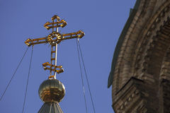 Close up of orthodox church cross on blue sky background Royalty Free Stock Photography