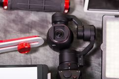 Close up of an Osmo Mobile gimbal, new generation of electronic stabilizer over a gray background.  royalty free stock images