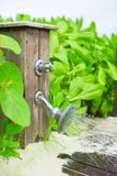 Close up outdoor beach shower at exotic resort Royalty Free Stock Photos