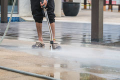 Close up Outdoor floor cleaning with high pressure water jet Stock Photos
