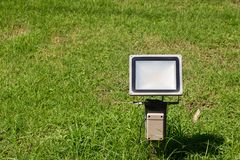 Close up outdoor LED lamp on the yard. Electrical light in the night. image for background, stock image