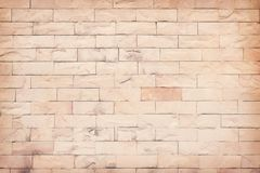 Outdoor old brown stone tones wall abstract patterns for background or texture. Close up Outdoor old brown stone tones wall abstract patterns for background or royalty free stock image