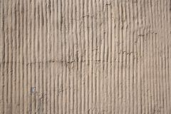 Close up outdoor view of a concrete striped surface. Abstract design of a rough grey texture with shadows. Detail of a. Modern building wall with rugged stock photos