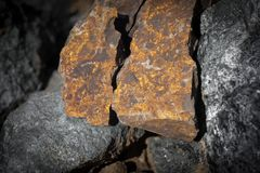 Close up outdoor view of stone on the ground. Piece of orange rocky stone. Beautiful texture stock photo