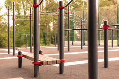 Close up outdoors gym equipment at the park sports ground. Different machines for training, activity at workout space. royalty free stock images
