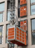 Close-up of outside construction lift. Close up of outside construction lift attached to London building Royalty Free Stock Image