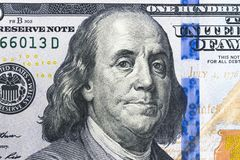 Close up overhead view of Benjamin Franklin face on 100 US dollar bill. US one hundred dollar bill closeup. Heap of one hundred Stock Photos