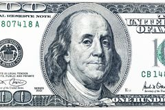Close up overhead view of Benjamin Franklin face on 100 US dollar bill. US one hundred dollar bill closeup. Heap of one hundred. Dollar bills on money royalty free stock photography
