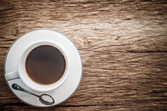 Close up overhead view of a cup of espresso coffee on a old wood. Stock Images
