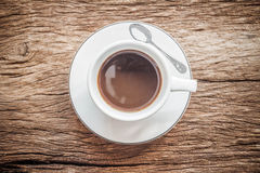 Close up overhead view of a cup of espresso coffee on a old wood. Royalty Free Stock Photography