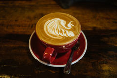 Close up overhead view of a cup of strong frothy coffee . Stock Images