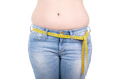 Close up of overweight woman's belly isolated on white Royalty Free Stock Images