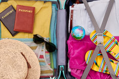 Close up of packed suitcase. Essential stuff for summer resort in traveler bag Royalty Free Stock Image