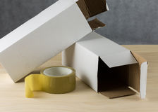 Close up Packing Tape and white boxes Royalty Free Stock Photos