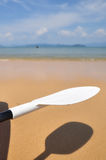 Close-up paddle of kayak boat with shadow on tropical beach background Royalty Free Stock Photography