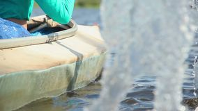 Close-up paddles entering water, rowing boat. Couple on vacation. Stock footage stock video footage