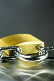 Close-up of Padlock with Chain. Strong Security Lock & Chain on a metal background Royalty Free Stock Images