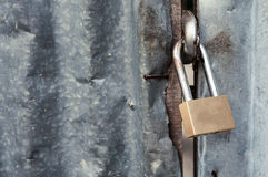 Close up, Padlock with old corrugated iron fence Stock Photos
