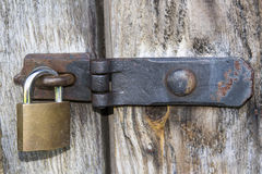 Close up of padlock and old metal hasp and staple Stock Images