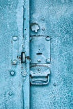 Close up of padlock and old metal hasp on an vintage door Stock Photography