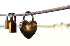 Close-up of Padlocks on Railing Against Sky Royalty Free Stock Images