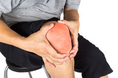 Close up on the painful knee joint of a matured man Royalty Free Stock Images