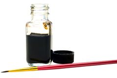 Close-up of paint bottle with paintbrush Stock Photography