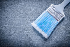 Close up paint brush with blue bristle and white handle Stock Photo
