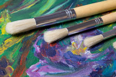 Close up of paint brushes on canvas background Stock Photography