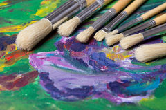 Close up of paint brushes on canvas background Stock Photos