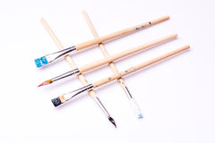 Close up of paint brushes on white background Royalty Free Stock Image