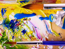 Close up of paint mixed on palette. stock image