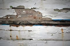 Close up of paint peeling off old wooden ship stock photography