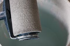 Close up paint roller on A bucket stock images