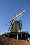 Close up of paint wind mill. Windmill; wood; Historical; Zaanse Schans; Holland; the Netherlands; Wintertime; blue-sky; water; river; Typical Dutch; Zaans Stock Images