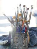 Close-up of paintbrushes in dirty old metal jar Royalty Free Stock Images