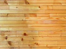 Close up painted  pine wood plank texture and background. Close up of golden painted pine wood plank texture and background stock photo