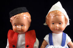 Close up of a pair of german dolls. Antique German dolls on black background Royalty Free Stock Image
