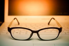 Close up pair of glasses on the laptop Royalty Free Stock Photography