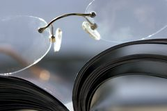 Close up on a pair of Glasses and the Magazine. Glasses and the Magazine - Extremen Close Up Royalty Free Stock Photo